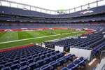 Members of the Denver Broncos take part in drills during an NFL football practice in empty Empower Field at Mile High, Saturday, Aug. 29, 2020, in Denver. (AP Photo/David Zalubowski)