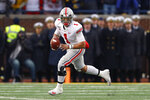 Ohio State quarterback Justin Fields rolls out to pass against Michigan in the second half of an NCAA college football game in Ann Arbor, Mich., Saturday, Nov. 30, 2019. (AP Photo/Paul Sancya)