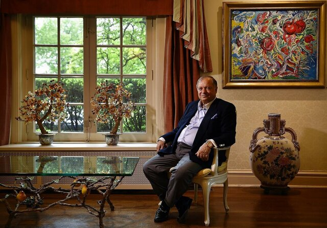 FILE - In this May 17, 2016,  file, photo, Farhad Azima, the owner, chairman and chief executive officer of Kansas City-based Aviation Leasing Group poses for a photo at his home in Kansas City, Mo. An Iranian-American aviation magnate and gunrunner tied to the CIA and the Iran-Contra scandal must pay a sheikhdom in the United Arab Emirates over $4.1 million over a series of business disputes, a British court ruled Friday, May 22, 2020. (Jill Toyoshiba/The Kansas City Star via AP, File)