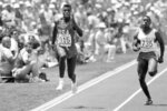 FILE - In this Aug. 3, 1984, file photo, U.S. athlete Carl Lewis of Houston, wins the second round of the 100-meter dash in 10.04 seconds to advance into the finals of the Summer Olympic Games at Memorial Coliseum in Los Angeles. (AP Photo/File)
