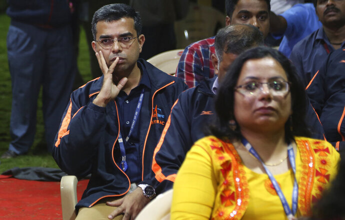 Indian Space Research Organization (ISRO) employees react as they wait for an announcement by organizations's chief Kailasavadivoo Sivan at its Telemetry, Tracking and Command Network facility in Bangalore, India, Saturday, Sept. 7, 2019. India's space agency says it has lost communication with its unmanned spacecraft that was set to touch down Saturday on the moon's south pole. (AP Photo/Aijaz Rahi)