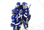 Tampa Bay Lightning goalie Andrei Vasilevskiy (88), Ryan McDonagh (27) and Barclay Goodrow (19) celebrate a win over the Dallas Stars in NHL Stanley Cup finals hockey action in Edmonton, Alberta, Monday, Sept. 21, 2020. (Jason Franson/The Canadian Press via AP)