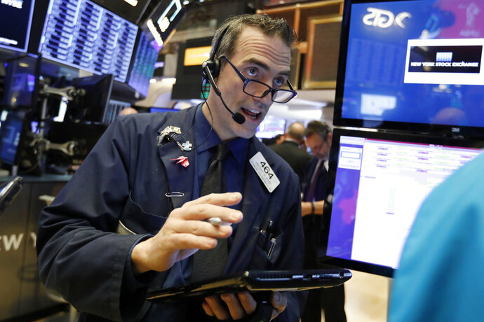 Trader Gregory Rowe works on the floor of the New York Stock Exchange, Wednesday, Jan. 9, 2019. Stocks are opening higher on Wall Street, putting the market on track for a fourth gain in a row. (AP Photo/Richard Drew)