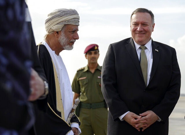 US Secretary of State Mike Pompeo is greeted by Oman's Minister of Foreign Affairs Yusuf bin Alawi bin Abdullah, left, upon his arrival in the Oman capital of Muscat, Friday Feb. 21, 2020. (Andrew Caballero-Reynolds/Pool via AP)