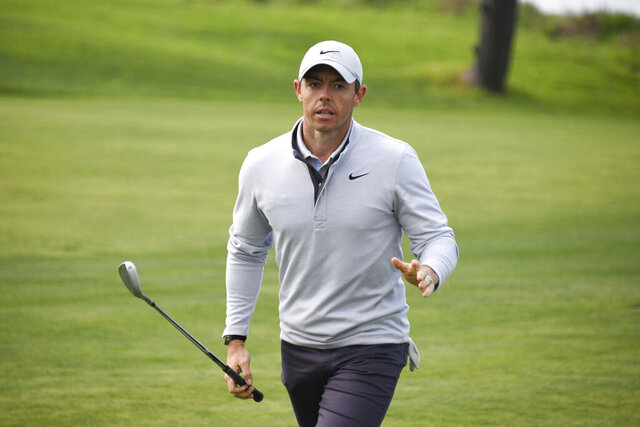 Rory McIlroy of Northern Ireland waves to the gallery after hitting out of a fairway bunker on the fourth hole of the South Course at Torrey Pines Golf Course during the second round of the Farmers Insurance golf tournament Friday Jan. 24, 2020, in San Diego. (AP Photo/Denis Poroy)