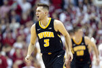 Iowa guard Jordan Bohannon reacts after hitting a shot against Indiana during the second half of an NCAA college basketball game in Bloomington, Ind., Thursday, Feb. 7, 2019. Iowa won 77-72. (AP Photo/AJ Mast)