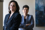 """In this May 21, 2021, photo Washington based civil rights attorneys Lisa Banks, left, and Debra Katz, pose for a portrait at their law firm in Washington. For many people, the pandemic year has brought a pause of some kind, or at least a slowdown, to their professional endeavors. For Katz and Banks, the opposite has been true. """"This is probably the biggest year we've ever had,"""" says Banks.  Their work has been increasing for nearly four years. When the Harvey Weinstein revelations erupted in October 2017,  launching the reckoning that became known as the #MeToo movement, it caused """"a sea change,"""" Katz says. (AP Photo/Jacquelyn Martin)"""