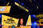Images of Alabama running back Najee Harris are displayed after the Pittsburgh Steelers made him the 25th pick in the first round of the NFL football draft, Thursday, April 29, 2021, in Cleveland. (AP Photo/Tony Dejak)