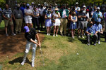 Rory McIlroy, of Northern Ireland hits out of the rough on the sixth hole during the first round of the Masters golf tournament on Thursday, April 8, 2021, in Augusta, Ga. (AP Photo/Charlie Riedel)