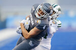 Nevada wide receiver Elijah Cooks (4) hangs onto the the ball for a 26-yard reception as Ohio cornerback Xavior Motley, behind, tries to dislodge it in the second half of the Famous Idaho Potato Bowl NCAA college football game Friday, Jan. 3, 2020, in Boise, Idaho. (AP Photo/Steve Conner)
