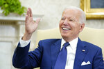President Joe Biden laughs during his meeting with Iraqi Prime Minister Mustafa al-Kadhimi in the Oval Office of the White House in Washington, Monday, July 26, 2021. (AP Photo/Susan Walsh)