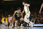 Purdue's Carsen Edwards, left, controls the ball against Minnesota's guard Amir Coffey, right, during the second half of an NCAA basketball game Tuesday, March 5, 2019, in Minneapolis. Minnesota won 73-69. (AP Photo/Stacy Bengs)