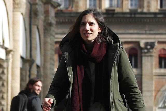 In this photo taken on Thursday, Jan. 30, 2020, Elly Schlein walks on a street after an interview with the Associated Press in downtown Bologna, Italy. A dual U.S.-Italian citizen who cut her political organizing teeth on two Barack Obama campaigns is emerging as the latest rising star in Italian politics.  (AP Photo/Antonio Calanni)