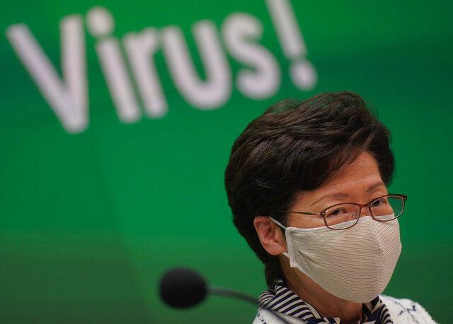 Hong Kong Chief Executive Carrie Lam listens to journalists questions during a press conference in Hong Kong, Monday, July 13, 2020. Hong Kong on Monday introduced more stringent social-distancing measures, banning public gatherings of more than four and making it compulsory to wear a mask on public transport as the city battles a fresh outbreak of locally-transmitted coronavirus infections. (AP Photo/Wally Santana)