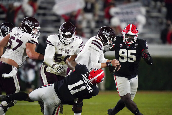 Georgia linebacker Jermaine Johnson (11) sacks Mississippi State quarterback Will Rogers during the second half of an NCAA college football game Saturday, Nov. 21, 2020, in Athens, Ga. (AP Photo/Brynn Anderson)