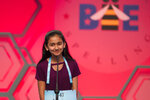 FILE - In this May 31, 2018 file photo, Naysa Modi, 12, from Frisco, Texas, spells her word incorrectly during the evening finals of the Scripps National Spelling Bee in Oxon Hill, Md.  An unremarkable sound can be the toughest thing for spellers to master at the Scripps National Spelling Bee. It's known as the schwa. It sounds like