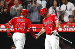 Los Angeles Angels' Rene Rivera, left, celebrates his home run with Mike Trout during the fifth inning of the team's baseball game against the Houston Astros on Tuesday, May 15, 2018, in Anaheim, Calif. (AP Photo/Jae C. Hong)