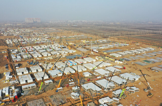 In this aerial photo released by China's Xinhua News Agency, workers build a large centralized quarantine facility capable of holding several thousand people in Shijiazhuang in northern China's Hebei Province, Saturday, Jan. 16, 2021. China on Saturday finished building a 1,500-room hospital for COVID-19 patients in Nangong, south of Beijing in Hebei Province, to fight a surge in infections the government said are harder to contain and that it blamed on infected people or goods from abroad. (Yang Shiyao/Xinhua via AP)