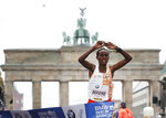 Ethiopia's Ashete Bekere crosses the finish line to win the 46th Berlin marathon in Berlin, Germany, Sunday, Sept. 29, 2019. (AP Photo/Michael Sohn)
