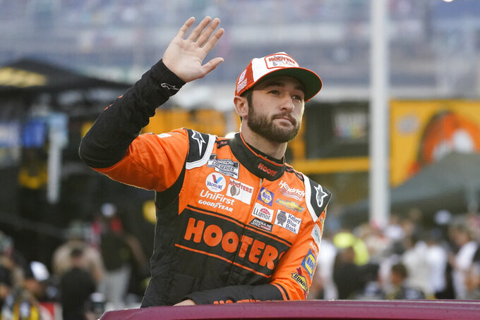 Chase Elliott waves to fans before a NASCAR Cup Series auto race at Bristol Motor Speedway Saturday, Sept. 18, 2021, in Bristol, Tenn. (AP Photo/Mark Humphrey)