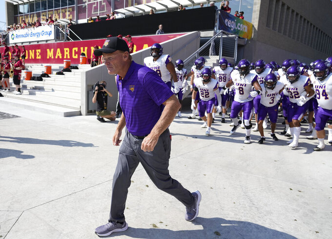 Northern Iowa head coach Mark Farley leads his team onto the field for an NCAA college football game against Iowa State, Saturday, Sept. 4, 2021, in Ames, Iowa. (AP Photo/Matthew Putney)