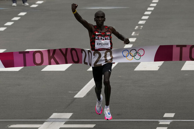 Eliud Kipchoge, of Kenya, celebrates after winning the gold medal in the men's marathon at the 2020 Summer Olympics, Sunday, Aug. 8, 2021, in Sapporo, Japan. (AP Photo/Shuji Kajiyama)