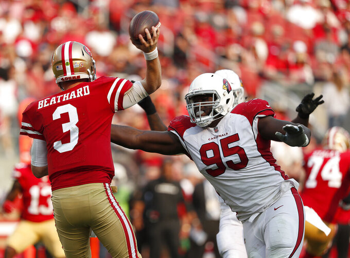 FILE - In this Oct. 7, 2018, file photo, Arizona Cardinals defensive tackle Rodney Gunter (95) pressures San Francisco 49ers quarterback C.J. Beathard (3) during the second half of an NFL football game in Santa Clara, Calif. Gunter, who signed as a free agent in March with the Jacksonville Jaguars, is stepping away from football because of an enlarged aorta. Gunter, who had been placed on the team's non-football injury list at the start of training camp, dropped the news in a statement Sunday, Aug. 16, 2020. (AP Photo/Tony Avelar, File)