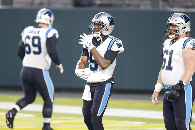 Carolina Panthers' Teddy Bridgewater warms up before an NFL football game against the Green Bay Packers Saturday, Dec. 19, 2020, in Green Bay, Wis. (AP Photo/Matt Ludtke)