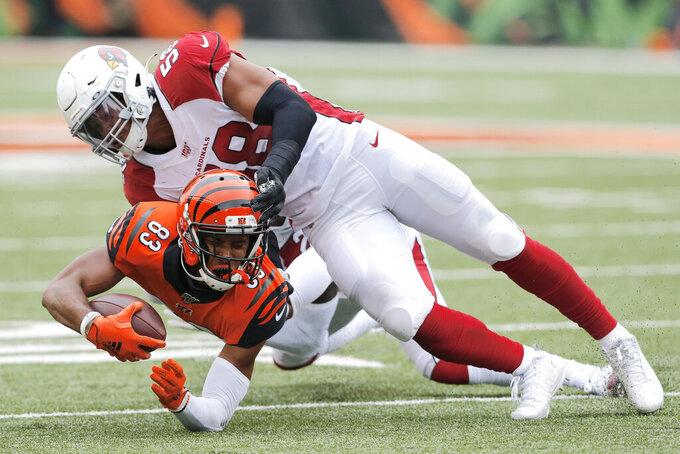 Cincinnati Bengals wide receiver Tyler Boyd (83) is tackled by Arizona Cardinals middle linebacker Jordan Hicks (58) in the second half of an NFL football game, Sunday, Oct. 6, 2019, in Cincinnati. (AP Photo/Gary Landers)