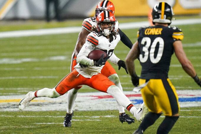 Cleveland Browns strong safety Sheldrick Redwine (29) runs after intercepting a pass by Pittsburgh Steelers quarterback Ben Roethlisberger during the first half of an NFL wild-card playoff football game, Sunday, Jan. 10, 2021, in Pittsburgh. (AP Photo/Keith Srakocic)