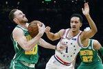Boston Celtics' Gordon Hayward (20) is defended by Philadelphia 76ers' Landry Shamet (1) during the first half of an NBA basketball game in Boston, Tuesday, Dec. 25, 2018. (AP Photo/Michael Dwyer)