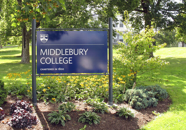 FILE - This Aug. 31, 2017, file photo, shows a sign for Middlebury College on the campus in Middlebury, Vt. Middlebury College in Vermont said it's offering some of its buildings as local officials craft emergency plans to help combat the coronavirus outbreak. (AP Photo/Wilson Ring, File)