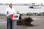In this May 11, 2021, file photo California gubernatorial candidate John Cox speaks in front of his Kodiak bear at a campaign event held on Shelter Island in San Diego. Cox was the Republican nominee for governor in 2018 and lost to Newsom in a landslide. This time around the multimillionaire businessman has displayed a showman's instincts. (AP Photo/Denis Poroy, File)