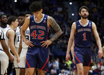 St. Mary's Dan Fotu (42) and Jordan Hunter (1) walk downcourt near the end of the second half of a first round men's college basketball game against Villanova in the NCAA Tournament, Thursday, March 21, 2019, in Hartford, Conn. (AP Photo/Elise Amendola)
