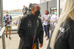 Mercedes driver Lewis Hamilton of Britain arrives ahead of Sunday's Formula One Dutch Grand Prix at the Zandvoort racetrack, Netherlands, Thursday, Sept. 2, 2021. (AP Photo/Francisco Seco)