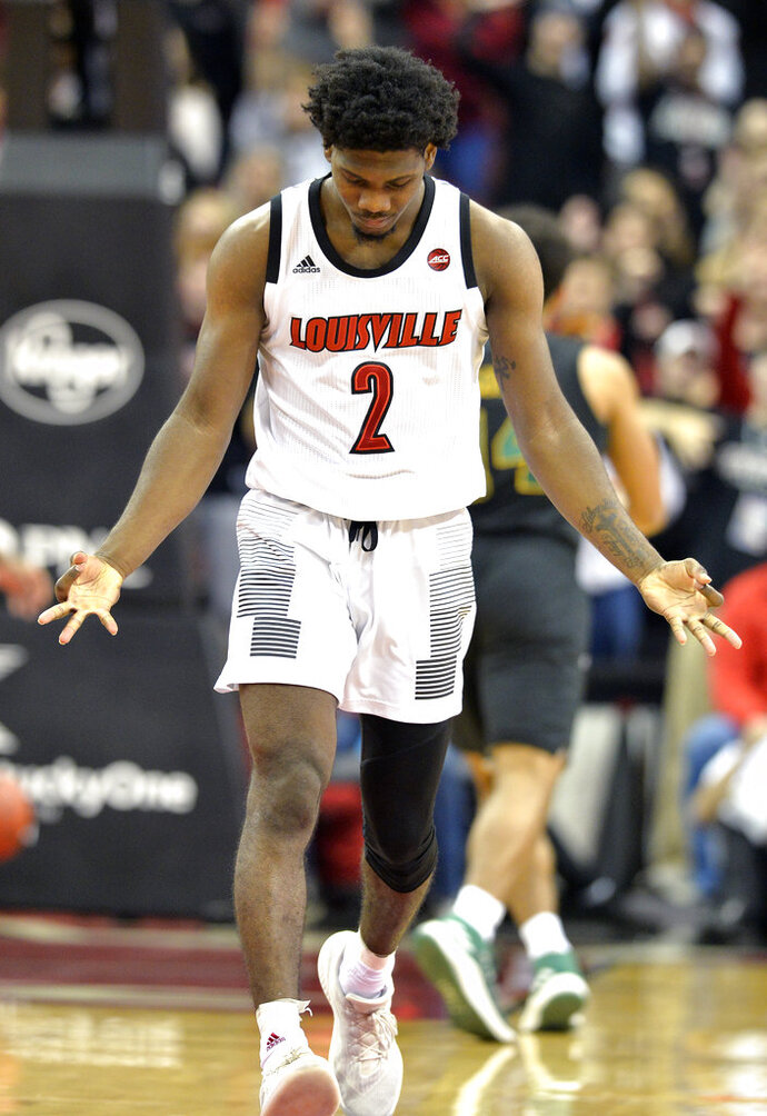 Louisville guard Darius Perry gestures after hitting a 3-point shot during the first half of an NCAA college basketball game against Vermont in Louisville, Ky., Friday, Nov. 16, 2018. (AP Photo/Timothy D. Easley)