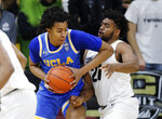 UCLA center Moses Brown, left, muscles in to shoot as Colorado forward Evan Battey defends in the second half of an NCAA college basketball game Thursday, March 7, 2019, in Boulder, Colo. (AP Photo/David Zalubowski)