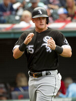 Chicago White Sox's Andrew Vaughn celebrates after scoring on a single by Leury Garcia during the sixth inning of a baseball game in Cleveland, Sunday, Sept. 26, 2021. (AP Photo/Phil Long)