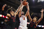 Southern California forward Nick Rakocevic, center, and Stanford forwards Jaiden Delaire, left, and Oscar da Silva vie for a rebound during the first half of an NCAA college basketball game in Los Angeles, Saturday, Jan. 18, 2020. (AP Photo/Kelvin Kuo)