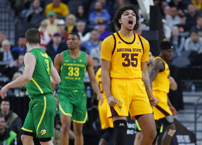 Arizona State's Taeshon Cherry (35) celebrates after a play against Oregon during the first half of an NCAA college basketball game in the semifinals of the Pac-12 men's tournament Friday, March 15, 2019, in Las Vegas. (AP Photo/John Locher)