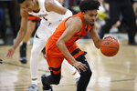 Oregon State guard Stephen Thompson Jr., front, picks up the ball as Colorado guard Tyler Bey pursues in the first half of an NCAA college basketball game Thursday, Jan. 31, 2019, in Boulder, Colo. (AP Photo/David Zalubowski)