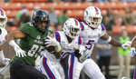 Hawaii wide receiver Marcus Armstrong-Brown (85) runs with the football while being pursued by Louisiana Tech safety James Jackson (10) and cornerback Michael Sam (5) in the first half of the Hawaii Bowl NCAA college football game, Saturday, Dec. 22, 2018, in Honolulu. (AP Photo/Eugene Tanner)