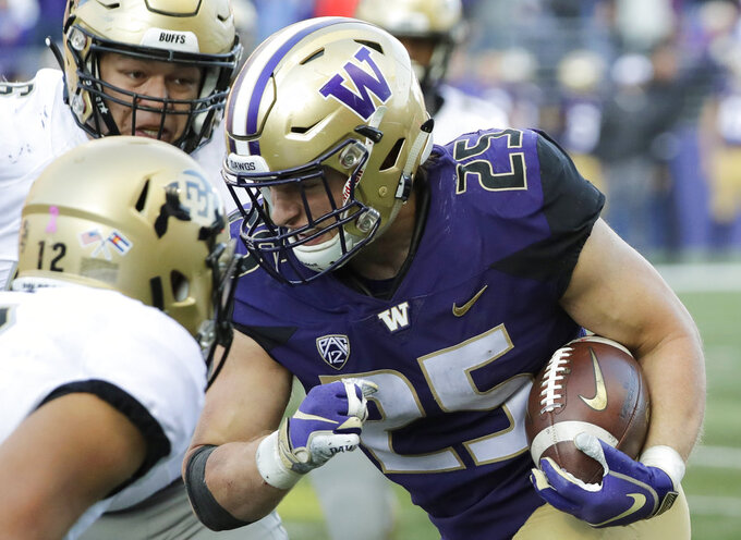 Washington linebacker Ben Burr-Kirven (25) runs after he intercepted a pass thrown by Colorado quarterback Steven Montez (12) during the second half of an NCAA college football game, Saturday, Oct. 20, 2018, in Seattle. Washington won 27-13. (AP Photo/Ted S. Warren)