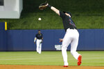 Miami Marlins right fielder Garrett Cooper drops a ball hit by Kansas City Royals' Adalberto Mondesi during the third inning of a baseball game, Saturday, Sept. 7, 2019, in Miami. Mondesi reached first on the error. (AP Photo/Wilfredo Lee)