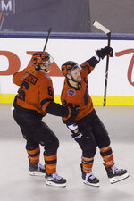 Philadelphia Flyers' Claude Giroux, right, celebrates with Travis Sanheim after he scored against the Pittsburgh Penguins during overtime of an NHL Stadium Series hockey game at Lincoln Financial Field, Saturday, Feb. 23, 2019, in Philadelphia. Philadelphia won 4-3. (AP Photo/Matt Rourke)