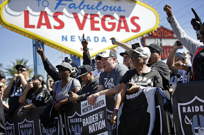 FILE - In this April 29, 2017, file photo, fans cheer as the Oakland Raiders announce their fourth round draft pick during an NFL football draft event in Las Vegas. The NFL was so petrified of being associated with gambling or sports betting that up until recently players were forbidden to go into casinos, and anything associated with Las Vegas was suspect. (AP Photo/John Locher, File)