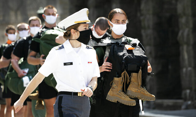 A West Point cadet leads a formation of new cadets, Monday, July 13, 2020, at the U.S. Military Academy in West Point, N.Y. The Army is welcoming more than 1,200 candidates from every state. Candidates will be COVID-19 tested immediately upon arrival, wear masks, and practice social distancing. (AP Photo/Mark Lennihan)