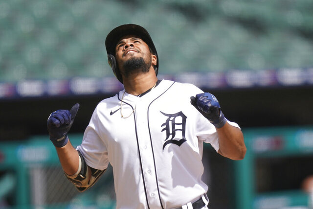 Detroit Tigers' Jeimer Candelario approaches home plate after a solo home run off Minnesota Twins starting pitcher Kenta Maeda during the fourth inning of a baseball game, Sunday, Aug. 30, 2020, in Detroit. (AP Photo/Carlos Osorio)