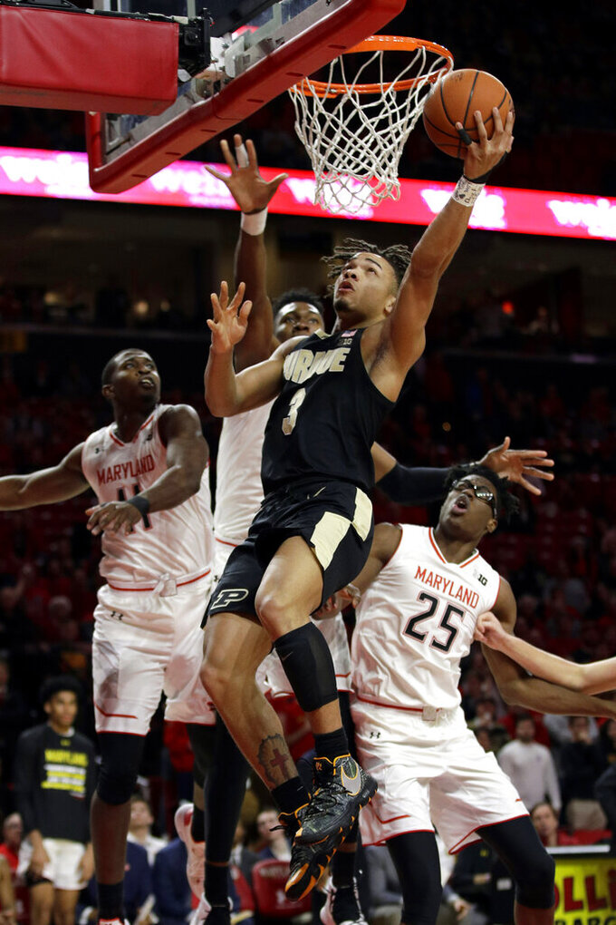 Purdue guard Carsen Edwards, center, shoots against Maryland guard Darryl Morsell, forward Bruno Fernando and forward Jalen Smith, from left, during the first half of an NCAA college basketball game Tuesday, Feb. 12, 2019, in College Park, Md. (AP Photo/Patrick Semansky)