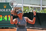 """FILE - In this May 12, 2021, file photo, Naomi Osaka of Japan reacts after losing a point against Jessica Pegula of the United States during their match at the Italian Open tennis tournament, in Rome. Osaka's agent says the four-time Grand Slam champion will sit out Wimbledon and compete at the Tokyo Olympics. Stuart Duguid wrote Thursday, June 17, 2021, in an email that Osaka """"is taking some personal time with friends and family. She will be ready for the Olympics and is excited to play in front of her home fans."""" (AP Photo/Alessandra Tarantino, File)"""